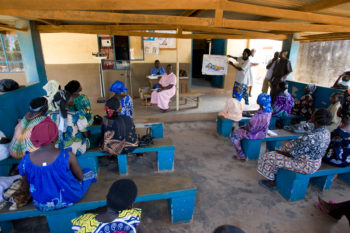 Women attend a health talk on malaria prevention from Drijaru Florence, a Community Health Worker and receive prenatal care at the Koboko health center.