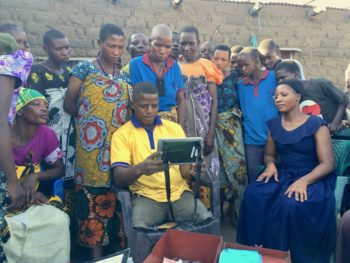 Tanzanians look at tablet computer