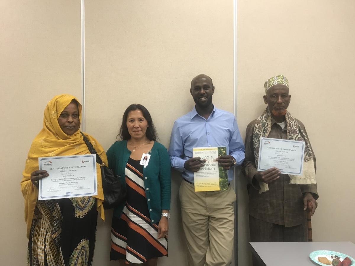 Graduates with Mailee and Abdirahman